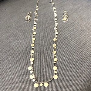 Silver Lia Sophia necklace and earrings set.